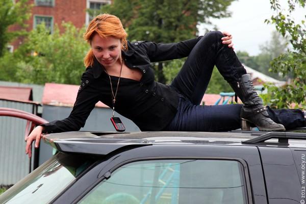 На крыше автомобиля.